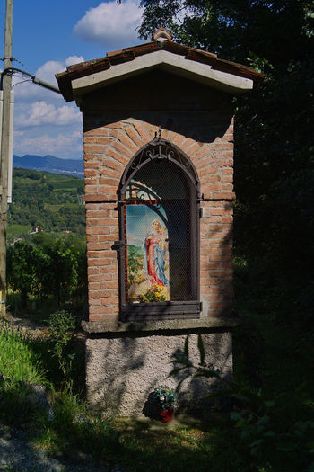 Small votive temple dedicated to the Madonna at Roncallo Green Hills Madonna Panorama Shadow And Light Sigma Architecture Building Exterior Built Structure Cappella Foveon In The Vineyard Italy Madonnina Outdoors Santella Shadows Sigma Sd15 Vineyard Votive Temple