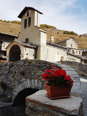 Mountain Mountain Village Stone Buildings Stone Bridge Old Buildings Travel Destinations Traveling In Mountain Valle Varaita Piedmont Italy Flower Built Structure Architecture No People Sky Outdoors Cross Building Exterior Day Nature