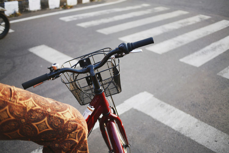 Bicycle Transportation Road Road Marking City Street Sign Symbol Land Vehicle Handlebar Mode Of Transportation Marking One Person Day Crosswalk Bicycle Basket Focus On Foreground Human Body Part Real People Human Hand Hand Outdoors