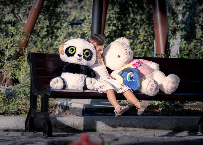 With friends Animal Representation Animal Themes Childhood Children Day Dog Doll Full Length Girl Kid Kids Looking At Camera Monkey One Person Outdoors Panda - Animal People Pets Portrait Stuffed Toy Young Adult