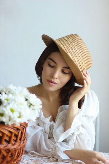 Portrait of a young woman sitting in basket