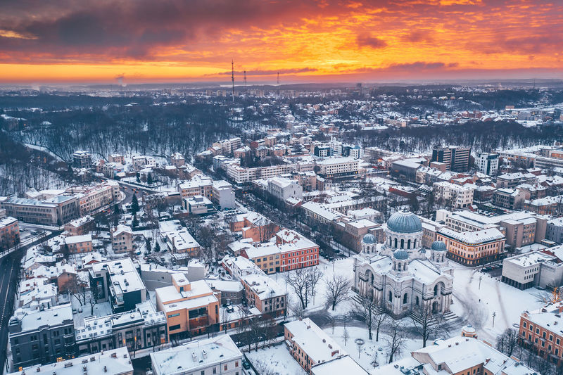 Orange sunset Drone  Aerial View Aerial Mavic 2 Mavic 2 Pro DJI X Eyeem Birds Eye View Church Soboras Architecture Building Exterior Built Structure Cityscape City Sky High Angle View Building Snow Crowd Winter Crowded Cold Temperature Residential District Nature Sunset Cloud - Sky Outdoors TOWNSCAPE Settlement