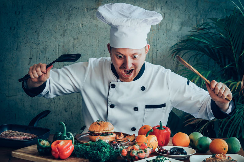 Shocked Chef Looking At Food On Table