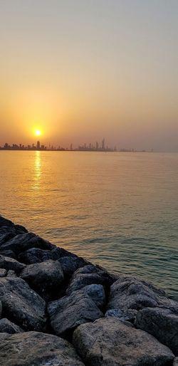 Sunset, Salmiya, Kuwait Water Sea Sunset Beach Winter Beauty View Into Land Horizon Sun Sunlight Coastal Feature Moody Sky Atmospheric Mood Romantic Sky Sky Only Reflection Lake EyeEmNewHere