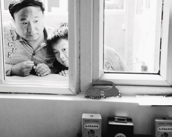 Snap A Stranger Indoors  Two People Childhood Window Looking At Camera Table Boys Home Interior Portrait Day Togetherness Smiling People Adult Father & Son