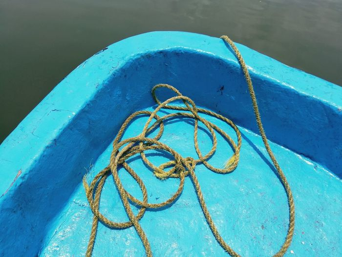 High angle view of rope in boat on lake