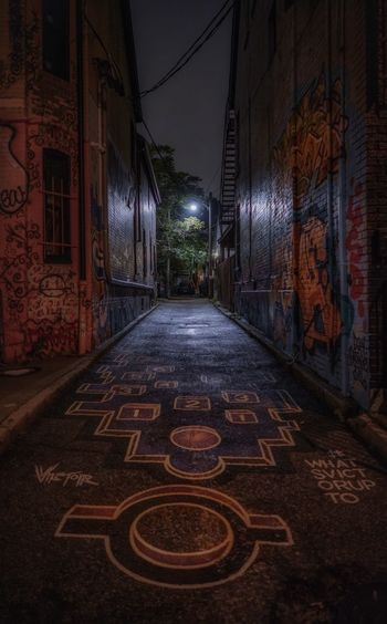 Graffiti Toronto Alley Architecture Building Building Exterior Built Structure City Diminishing Perspective Direction Empty Footpath Graffiti Art Illuminated Lighting Equipment Long Narrow Night No People Outdoors Residential District Street The Way Forward Wall