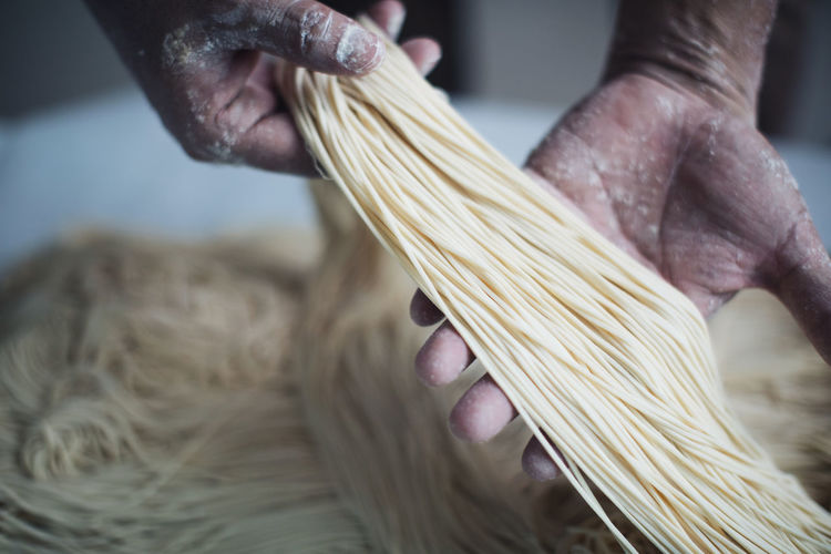Cropped image of chef making noodles