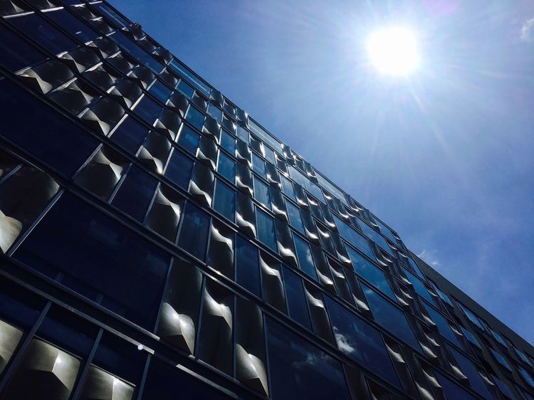 Sun Sunlight Architecture Building Exterior Low Angle View Sunbeam Built Structure Lens Flare Window Bright Barcelona Peace Sunset Love Family Bnw Sunny Office Building Modern Clear Sky Sky Building Story Tall - High Blue Repetition