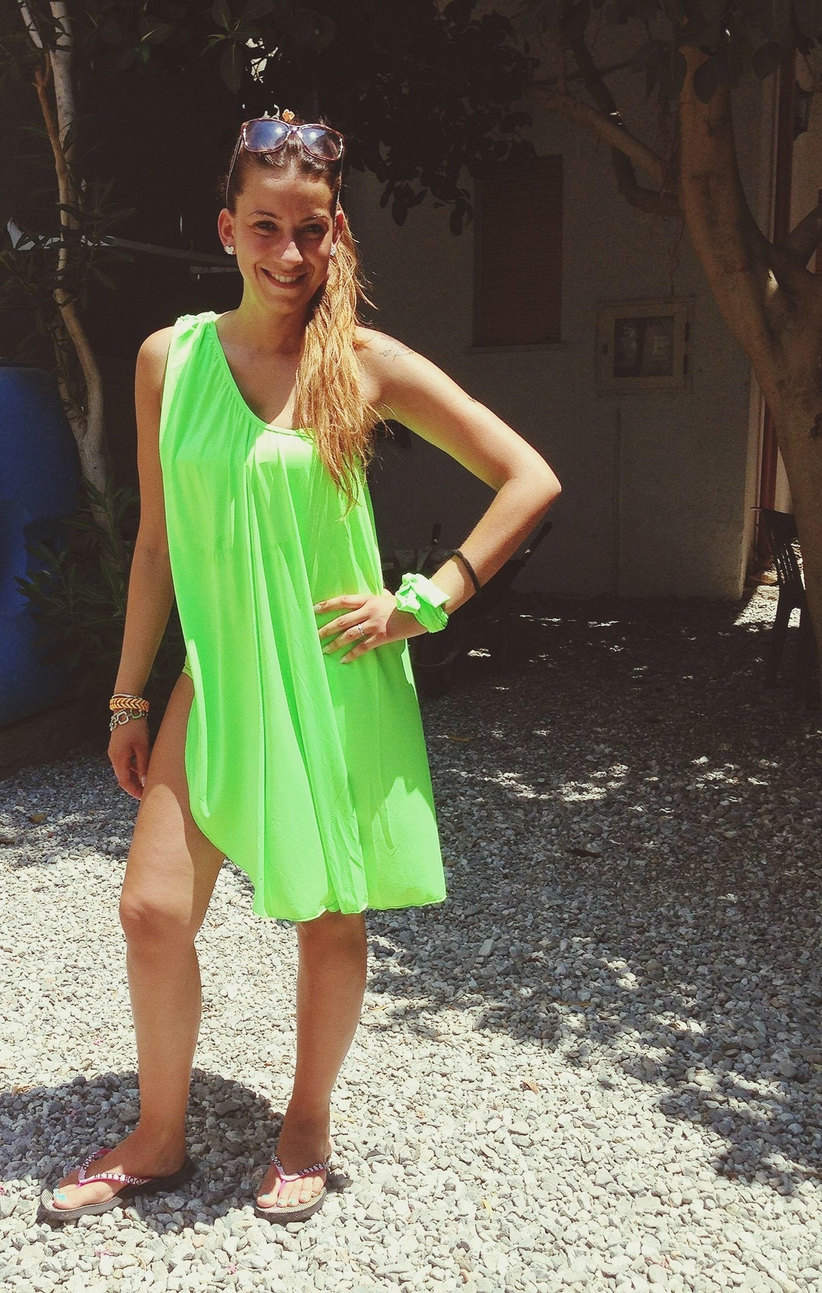 full length, person, lifestyles, young adult, casual clothing, leisure activity, front view, young women, standing, looking at camera, portrait, happiness, smiling, holding, three quarter length, dress, outdoors, fun