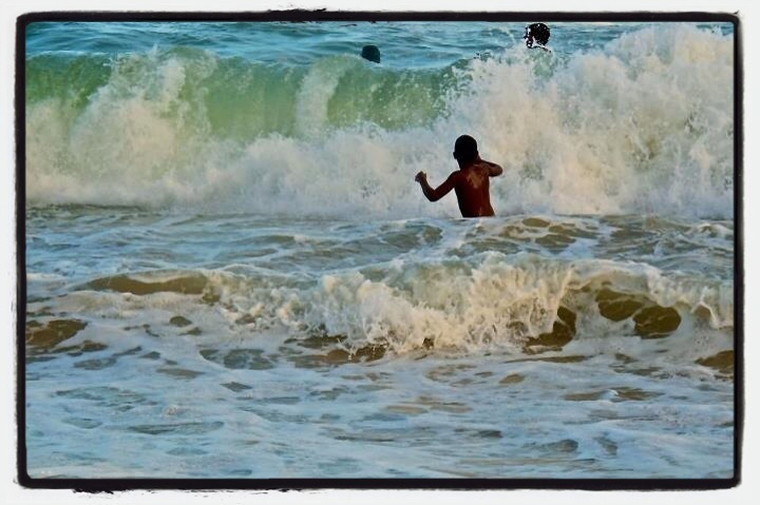 water, lifestyles, leisure activity, sea, transfer print, waterfront, men, motion, wave, full length, auto post production filter, surf, vacations, standing, splashing, nature, rear view, enjoyment