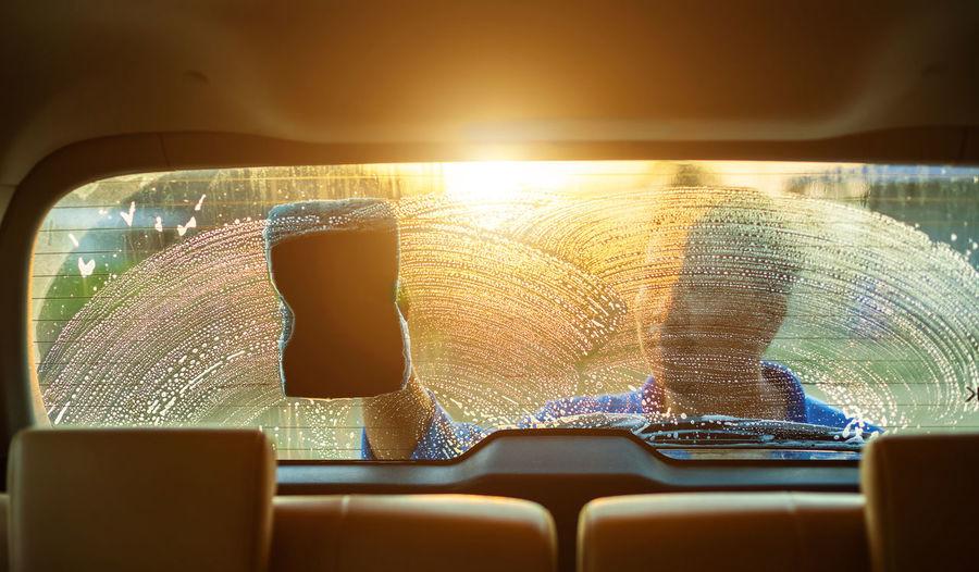 Close-up of woman seen through car window