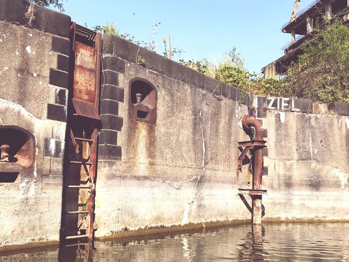 Wharf Rusty Water View Leipzig Light And Shadow Graffiti Architecture Built Structure Sky Building Exterior Nature Sunlight Water Leisure Activity