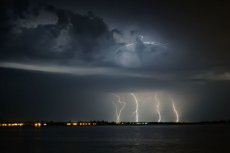 Lightning Over Lake At Night