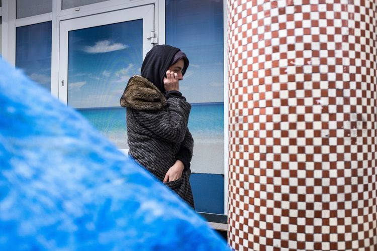 Street scene at Chmielna Street in Warsaw, Poland Angles Angular Chmiel Cold Temperature Geometry Landscape Mosaic One Person One Woman Only Only Women Outdoors Patterns Seascape Street Photography Streetphoto Streetphoto_color Streetphotography UNPOSED Warm Clothing Warsaw Warsaw Poland Winter