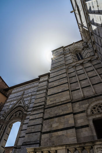 Shot in the city of Siena, Italy Against The Sun Architecture Building Building Exterior Built Structure City Clear Sky Day History Low Angle View Nature No People Old Outdoors Place Of Worship Sky Sunlight Sunstar The Past Travel Destinations Window