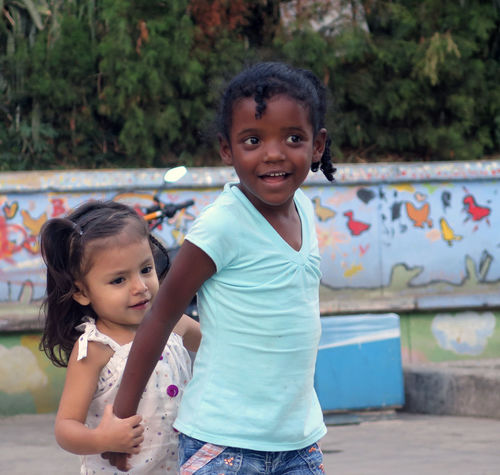 Kids in Comuna 13 Bonding Child Childhood Colombia Comuna 13 Enjoy The New Normal Friends Friendship Happiness Kids Kids Being Kids Looking At Camera Outdoors People Playground Portrait Smiling Travel Travel Photography What Who Where