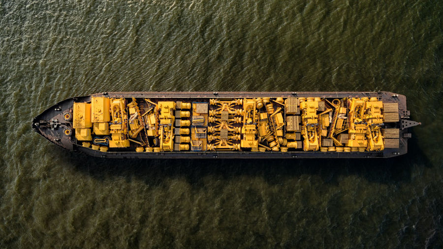 Ship on Danube River Close-up Communication Container Day Directly Above Food And Drink High Angle View Large Group Of Objects Nature No People Outdoors River Side By Side Still Life Transportation Water Waterfront Wood - Material Yellow