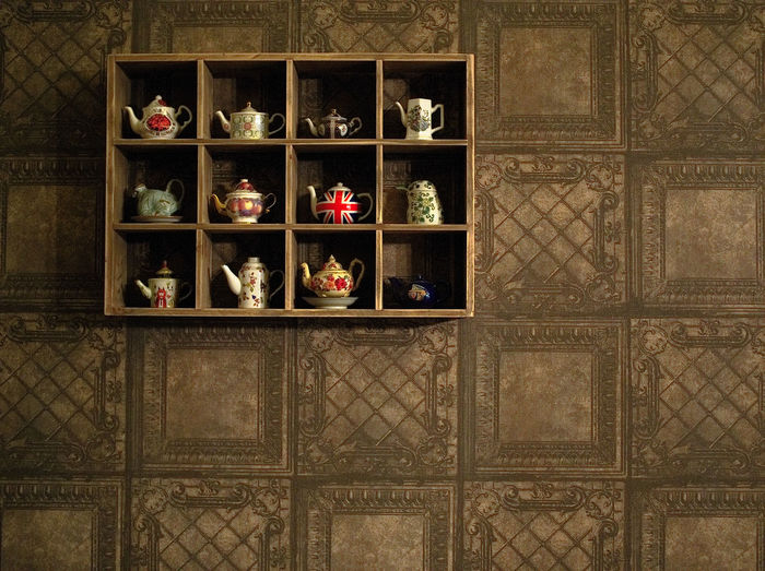 Various teapots in shelves