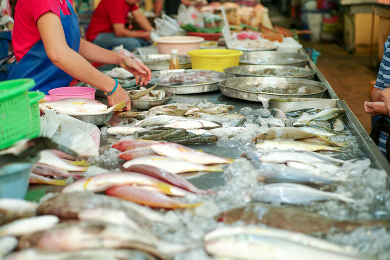 Selective focus on raw fresh fish on the tray for selling in the market