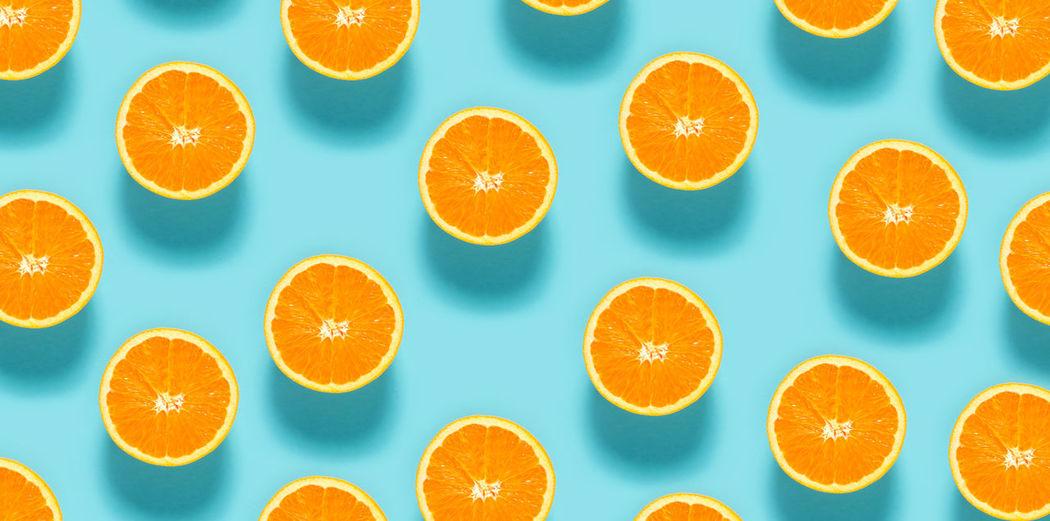 Directly above shot of orange fruits against white background