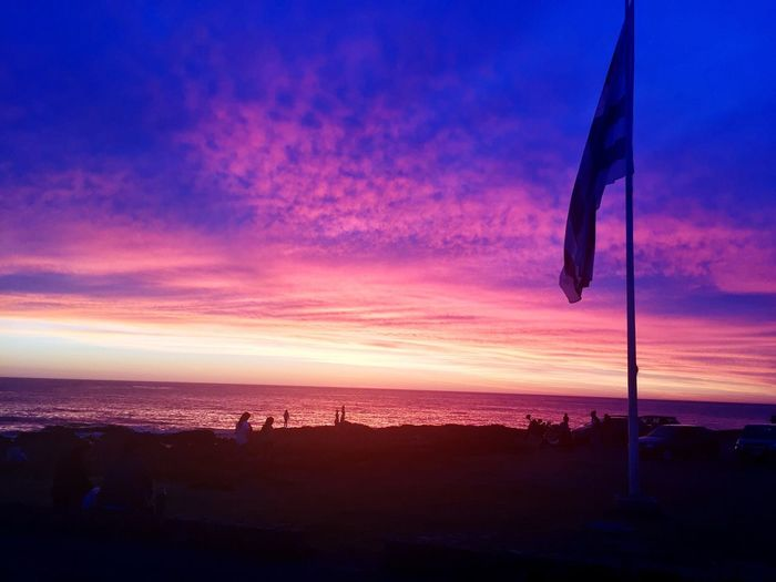 Neighborhood Map Sunset Sky Nature Scenics Flag Tranquil Scene Beauty In Nature Sea Tranquility Beach Horizon Over Water Uruguay -Punta Del Leste. Magic hour. Colorful Sky