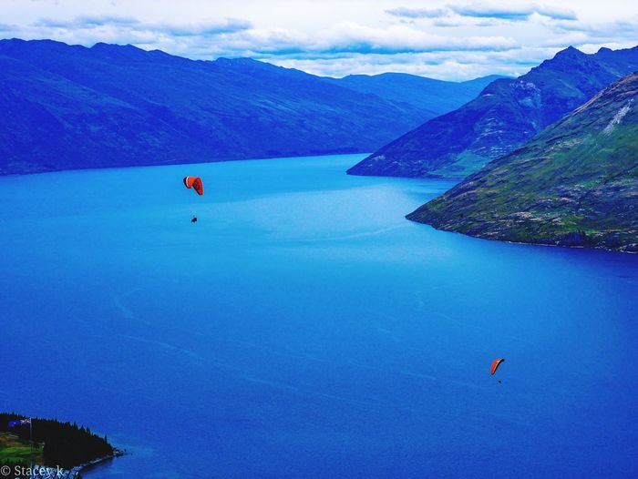 Queenstown, new zealand Summertime New Zealand Scenery New Zealand Summer Mountain Range EyeEm Selects Water Mountain Blue Sea Sky Landscape Parachute Skydiving Extreme Sports Calm Ocean Coast The Great Outdoors - 2019 EyeEm Awards