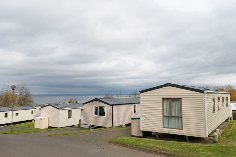 Ayr beach holiday park Architecture Built Structure Building Exterior Cloud - Sky Sky Building House Day No People Land Nature Grass Plant Beach Hut Residential District Beach Outdoors Overcast Landscape