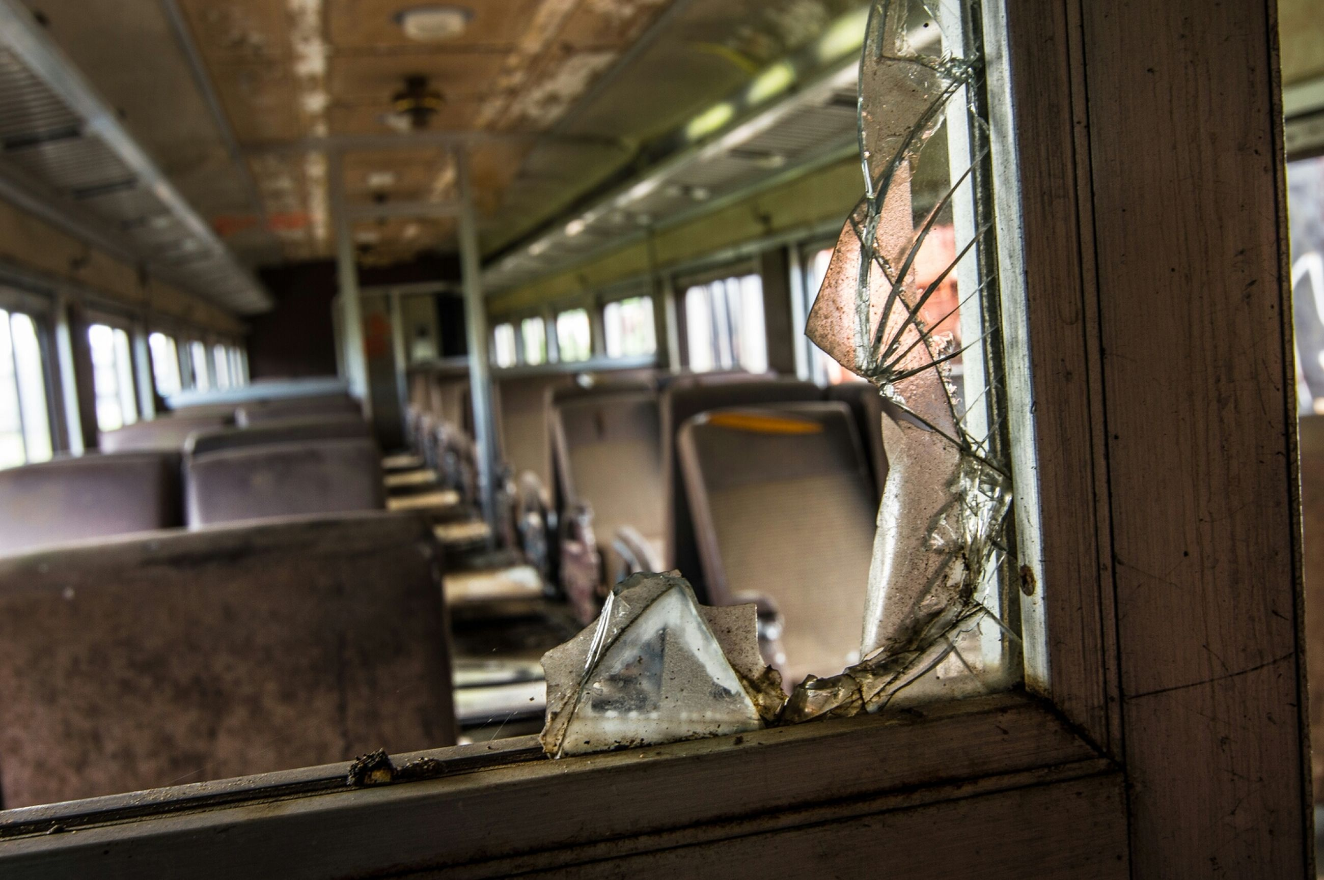 indoors, absence, public transportation, transportation, window, architecture, rail transportation, empty, interior, built structure, no people, train - vehicle, railroad track, reflection, table, illuminated, day, vehicle seat, chair, passenger train