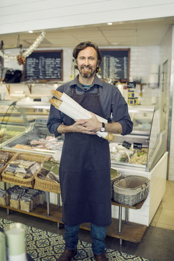 Portrait of a man standing in store