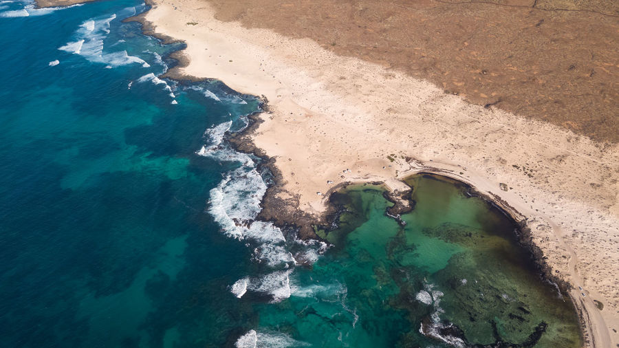 aerial view north coast of fuerteventura Water Sea High Angle View Nature Beauty In Nature No People Day Tranquility Scenics - Nature Tranquil Scene Land Beach Turquoise Colored Idyllic Outdoors Blue Aerial View Remote Sunlight