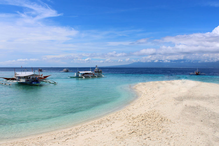 Beach Sea Sand Water Horizon Over Water Nautical Vessel Sky Outdoors Scenics Beauty In Nature Day Blue Cloud - Sky Nature Summer Vacations Travel Destinations Landscape