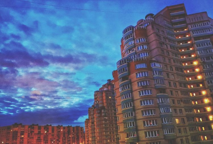 Low angle view of buildings against sky at dusk