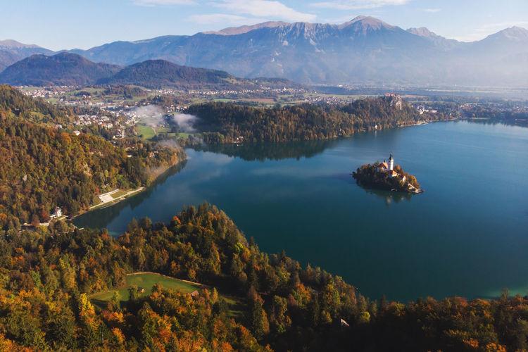 High angle view of lake amidst mountains