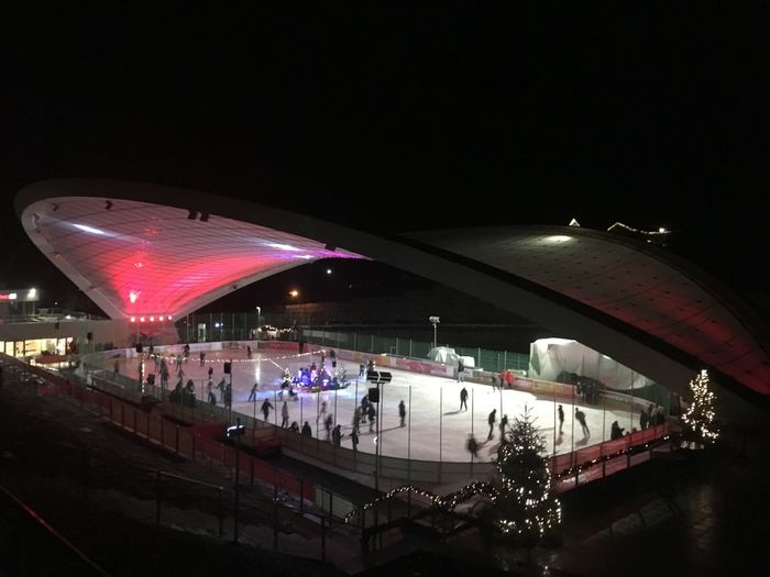 Wintersports Leisure Activity Party Arena Ice Arena Skating Ice Night Illuminated Architecture Transportation Incidental People City Built Structure Cold Temperature Building Exterior Winter Snow