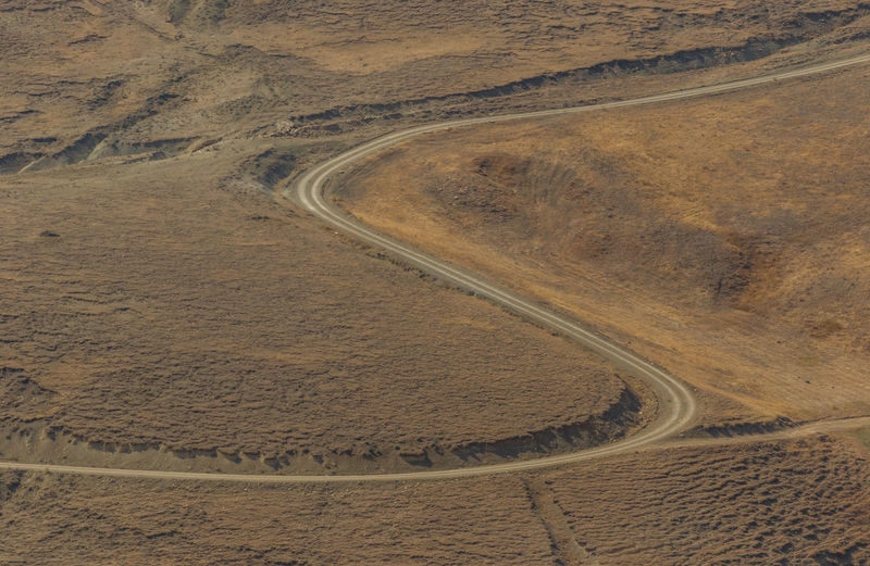 High angle view of road passing through land