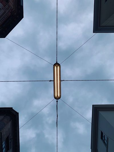 Look Up Cloud - Sky Sky Low Angle View Architecture Hanging Lighting Equipment Built Structure No People Building Exterior Outdoors Electricity  Light Technology Day
