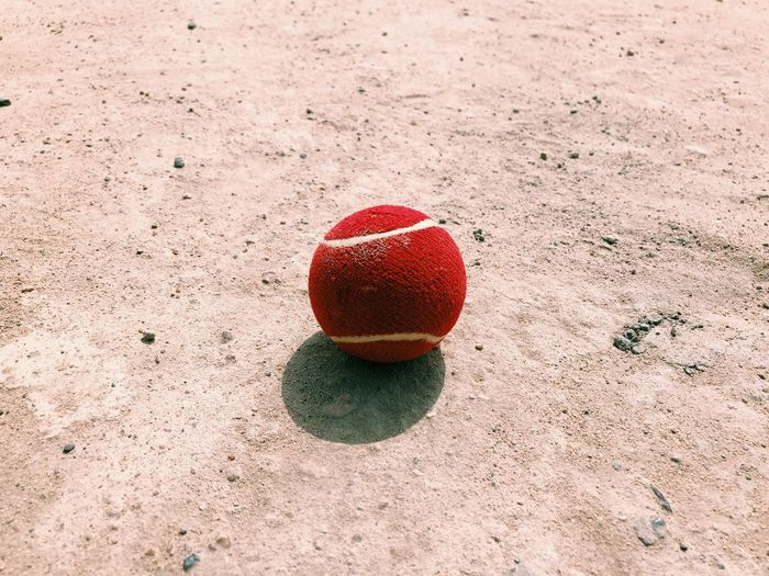 High angle view of red ball on field
