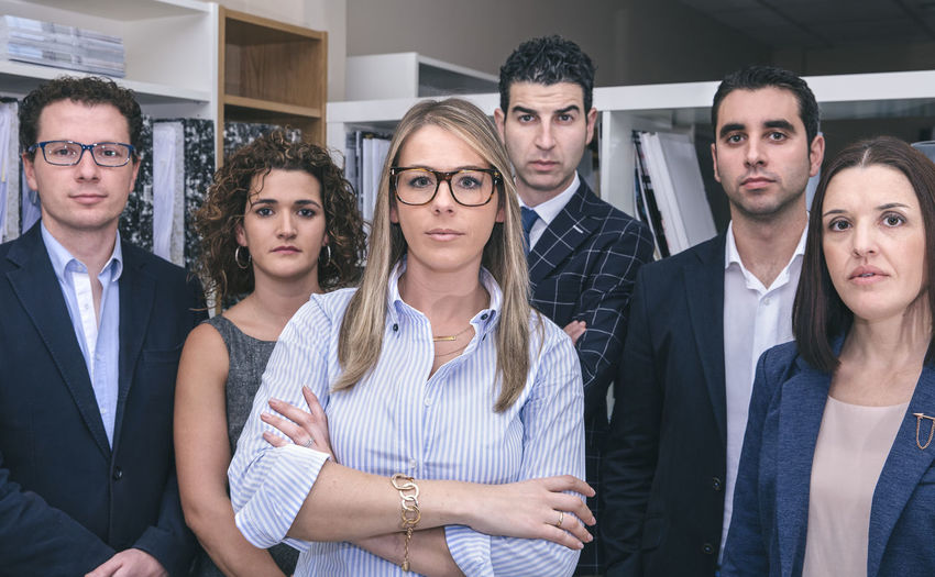 Executive team standing and looking at camera in headquarters Business Company Horizontal Man Office Smart Standing Teamwork Woman Working Business Finance And Industry Businessman Businesswoman Caucasian Chief Clever Female Headquarters Leadership Male People Portrait Six People Sucess Team