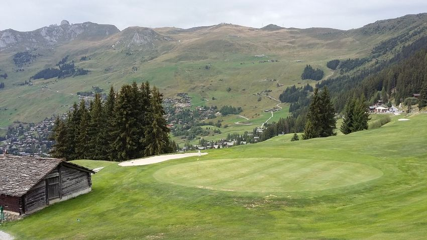 Piotr Mizerski Golf Grass Hiking Switzerland Alps Architecture Beauty In Nature Day Golf Course Grass Green Color Mountain Nature No People Outdoors Putting Green Scenics Sky Sport Trail Tree Verbier