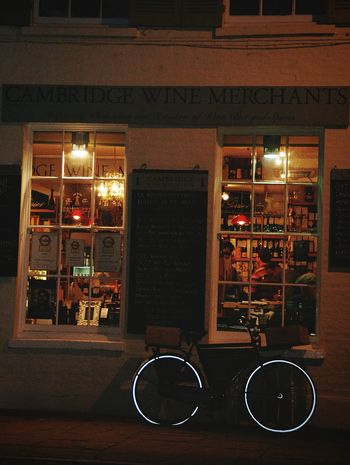 Bicycle Architecture Illuminated Store Building Exterior City Cambridge Wine Shop Dusk Cambridge, United Kingdom King's Parade