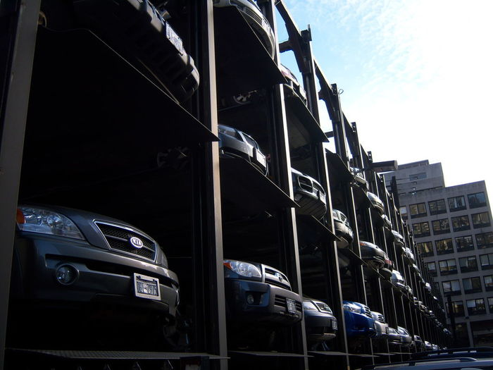 Architecture Building Exterior Built Structure Car City Day Land Vehicle Low Angle View Modern No People Outdoors Parking Lot Art Sky Transportation
