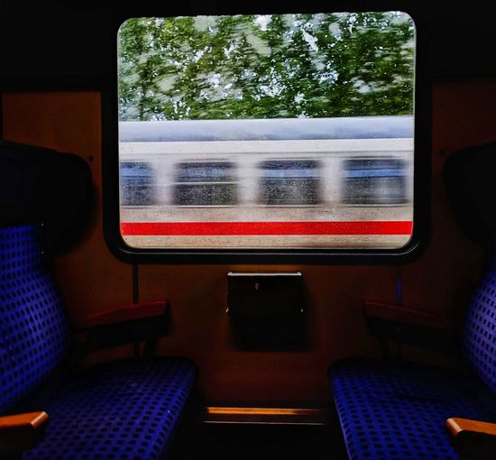 Contrast No People Man Made Object Indoor Photography Light And Shadow Glass - Material Window Seats Design Daylight Available Light Blue Vehicle Interior Passenger Train Train Interior Vehicle Seat Train - Vehicle Rail Transportation Train Public Transportation It's About The Journey
