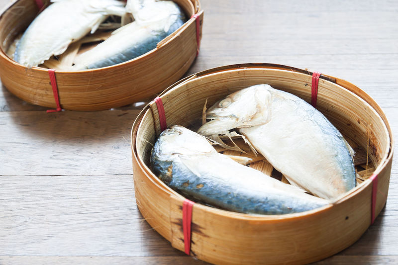 Steamed mackerels in basket on wooden table Bamboo - Material Basket Box - Container Close-up Cuisine Delicious Fish Food Food And Drink Freshness Healthy Eating Indoors  Kitchen No People Ready-to-eat Seafood Steamed  Still Life Table Wood - Material