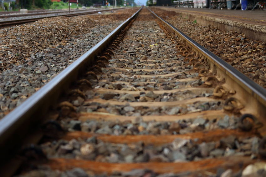 Train Tracks Backgrounds Day Diminishing Perspective Direction Gravel Long Metal Parallel Pebble Rail Transportation Railroad Track Rock Rock - Object Selective Focus Solid Surface Level The Way Forward Track Train Train Station Transportation Travel vanishing point