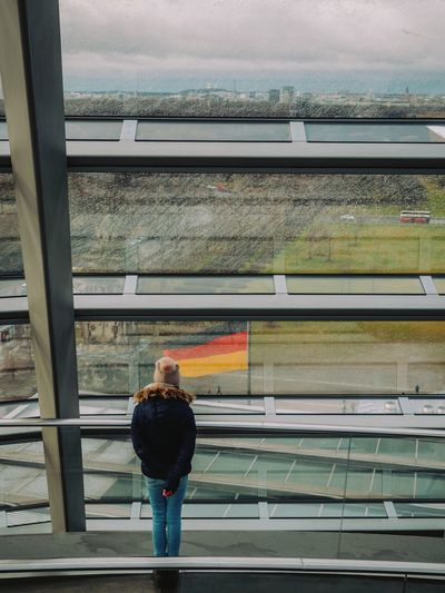 Railing Real People One Person Casual Clothing Full Length Day Leisure Activity Architecture Outdoors Built Structure Sky Reichstag Capture Berlin Berlin Germany Flag Dome View View From Above Urban Landscape