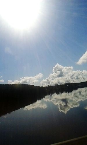The first days of spring Sun Clouds Water Reflections Purenature Lake
