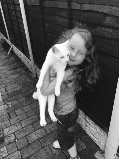 Pets Full Length Childhood Real People One Person Domestic Animals One Animal Dog Casual Clothing Animal Themes Leisure Activity Bonding Mammal Cute Day Lifestyles Outdoors Elementary Age Love Hugging Cats Blackandwhite Photography Blackandwhite Black And White Photography Black And White The Portraitist - 2017 EyeEm Awards