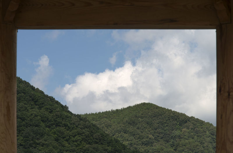 mountain with white cloud and blue sky in the frame of a pavilion Osipcheon Beauty In Nature Blue Sky Cloud - Sky Day Frame In Frame Growth Landscape Low Angle View Mountain Nature No People Outdoors Plant Scenics Sky Tranquil Scene Tranquility Tree White Cloud Yeongdeok