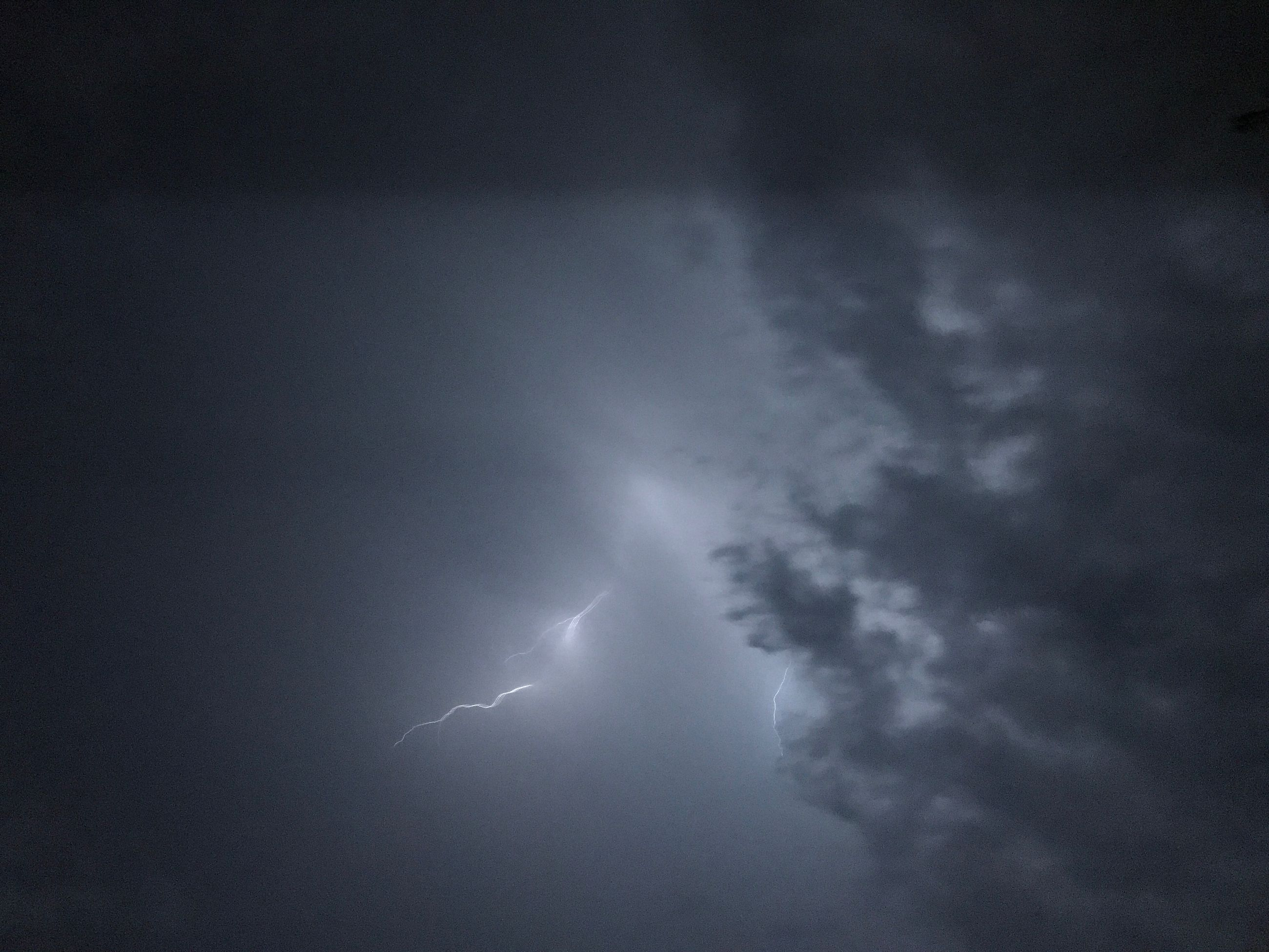 lightning, weather, power in nature, beauty in nature, storm, sky, thunderstorm, storm cloud, nature, forked lightning, dramatic sky, cloud - sky, atmospheric mood, scenics, danger, silhouette, no people, outdoors, natural phenomenon, night, low angle view